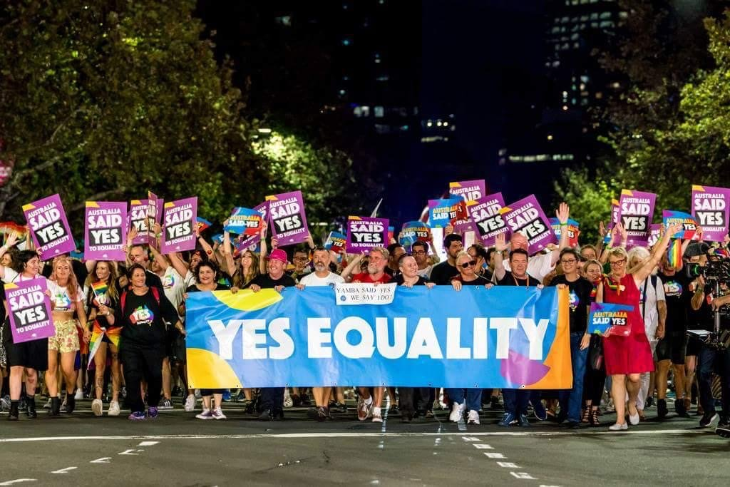 A parade of colour showing the Yes Equality signs